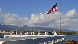 Members of the Joint Base Pearl Harbor-Hickam Honors and Ceremonies prepare to render a rifle salute during an ash scattering ceremony for Pearl Harbor survivor Benzion