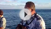 Hawaiian Musician During Ash Scattering Service at Sea